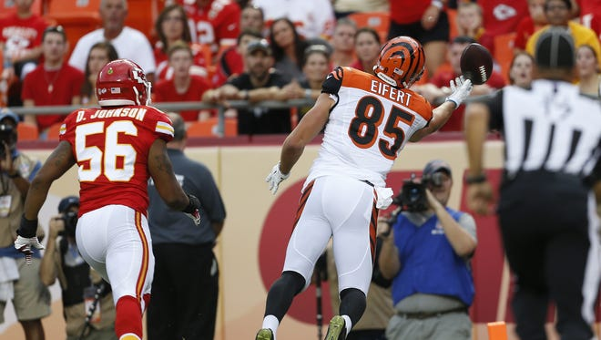 Cincinnati Bengals tight end Tyler Eifert (85) can't make the reception in the corner of the end zone against the Kansas City Chiefs inside linebacker Derrick Johnson (56) in the first quarter at Arrowhead Stadium.