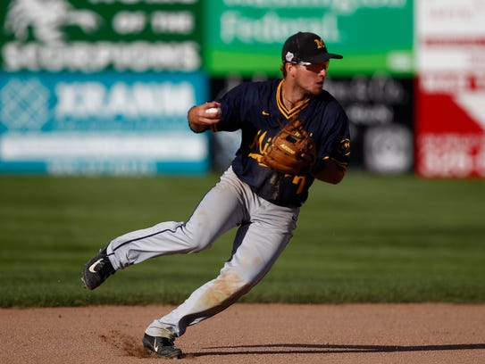 Midland shortstop Luke Waddell fields the ball against