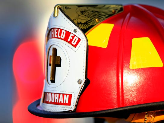 This Wednesday, Jan. 29, 2014 photo shows a helmet the Penfield Fire Department made for the family of Tyler Doohan, 9, to honor him at his funeral in Fairport, N.Y. for trying to rescue Lewis J. Beach and Stephen D. Smith who also died in a fire in their mobile home. (AP Photo/Democrat & Chronicle, Annette Lein)