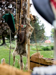 Handmade items and animal skins hang from a tent Friday,