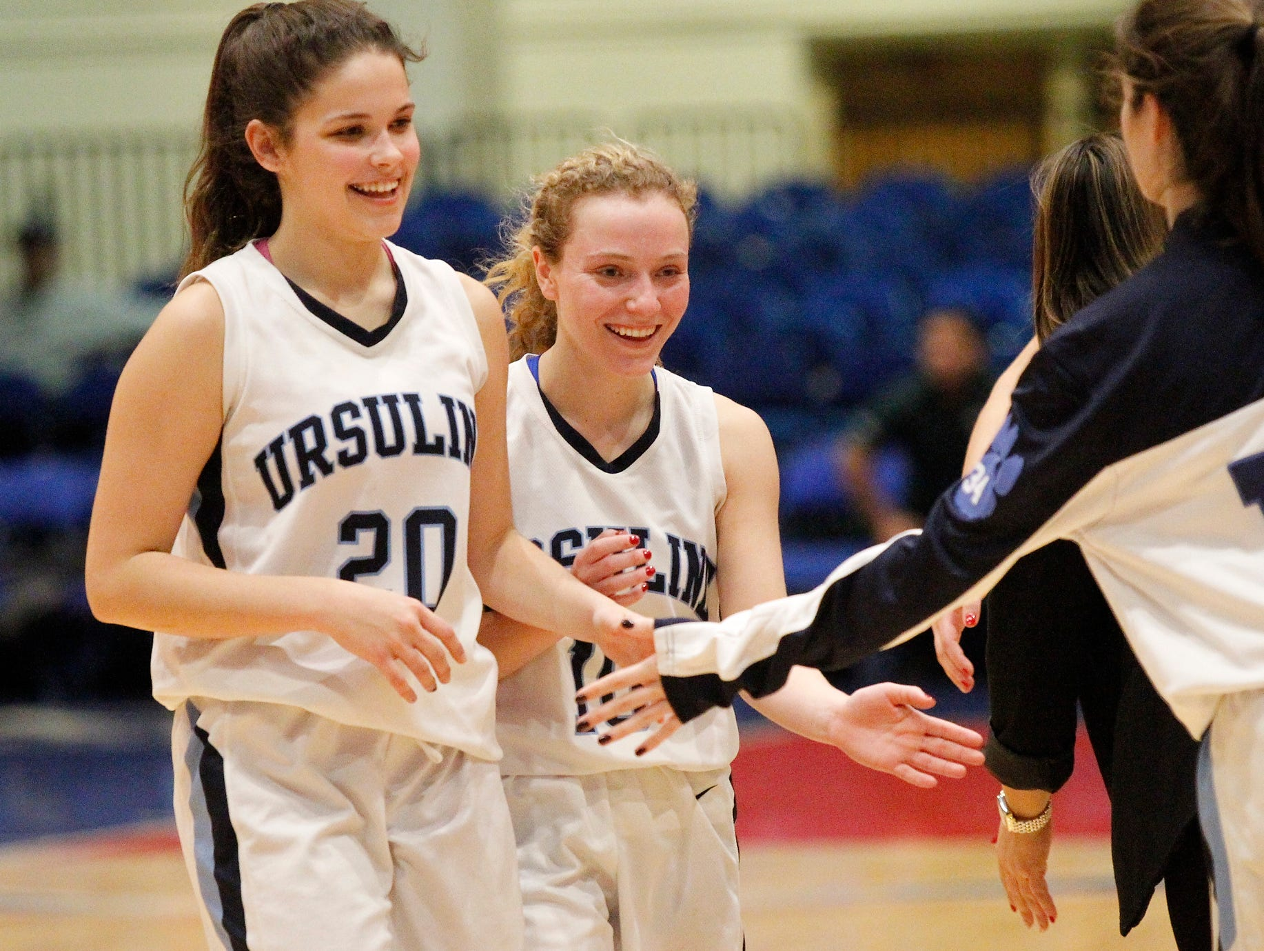 Ursuline defeats Monroe-Woodbury 47-40 in overtime during the Slam Dunk Tournament consolation game at the Westchester County Center on Tuesday, Dec. 29, 2015.
