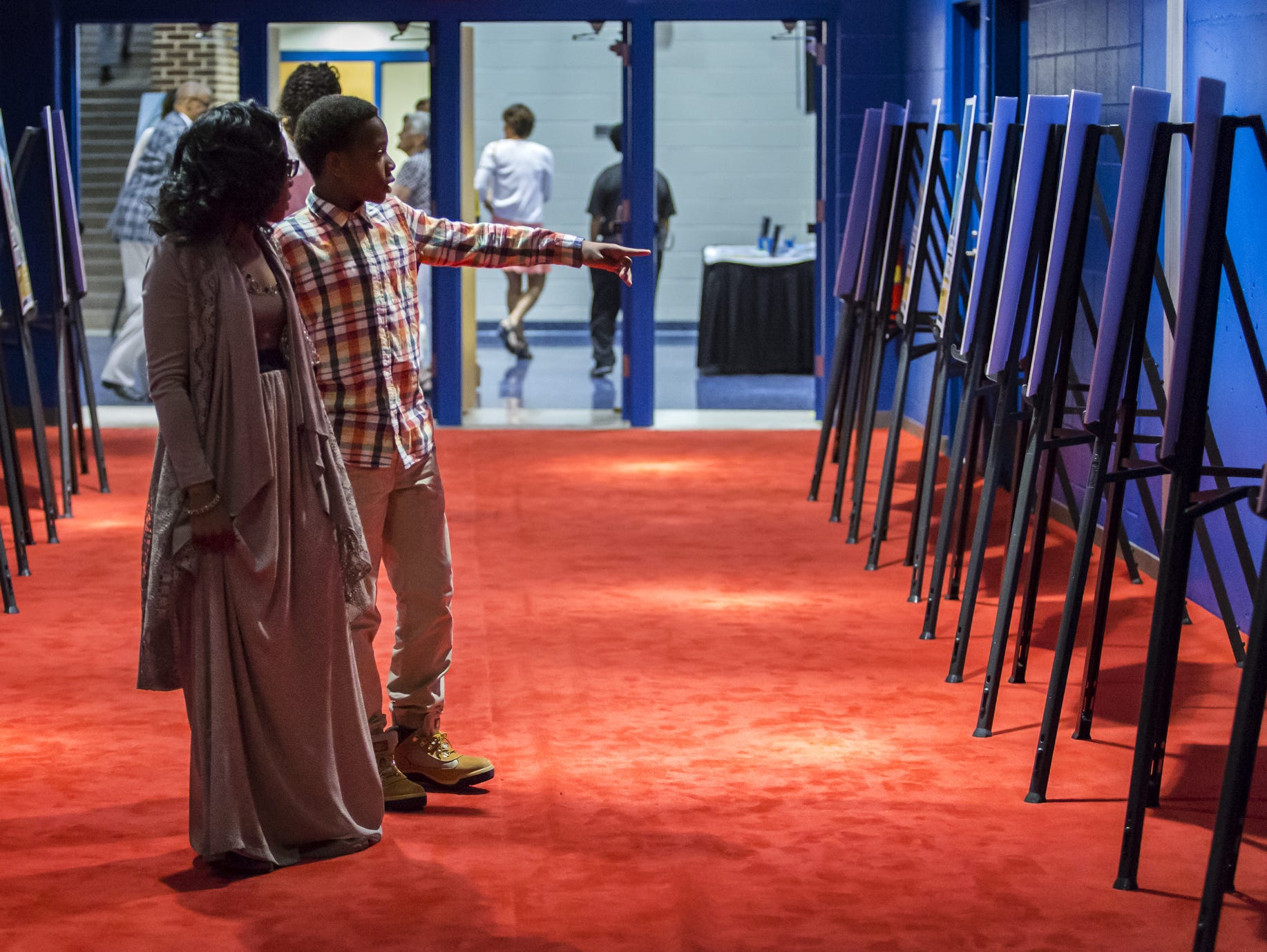 Keysha and Dariyon Williams, 8, check out posters of The News Journal's Athletes of the Week as they make their way down the red carpet for the Delaware Sports Awards banquet at the Bob Carpenter Center at the University of Delaware in Newark on Wednesday evening.