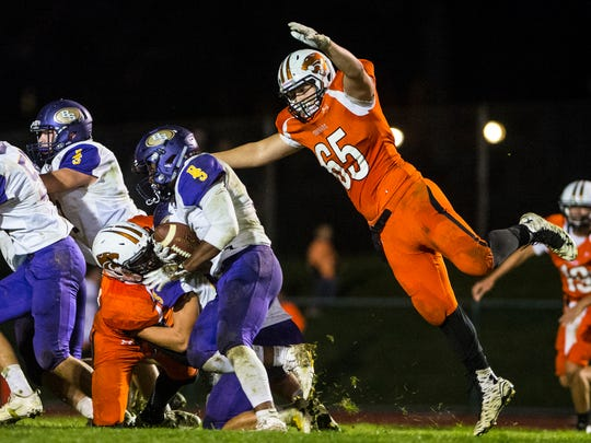 Palmyra's Xaiver Vazquez goes airborne to tackle Boiling Springs' Bryan Malone.