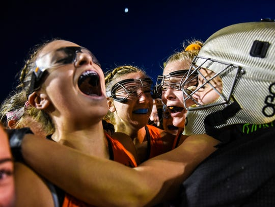 Lauren Wadas, Palmyra, left, lets out a scream of joy