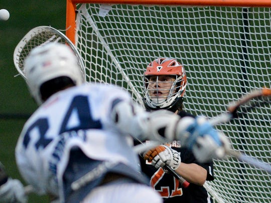 Central York goalie Blaze Hake moves to make a save on a shot on goal by Manheim Township's Anthony Gugluizza during the District 3 Class 3-A boys' lacrosse semifinal, Tuesday, May 23, 2017. John A. Pavoncello photo