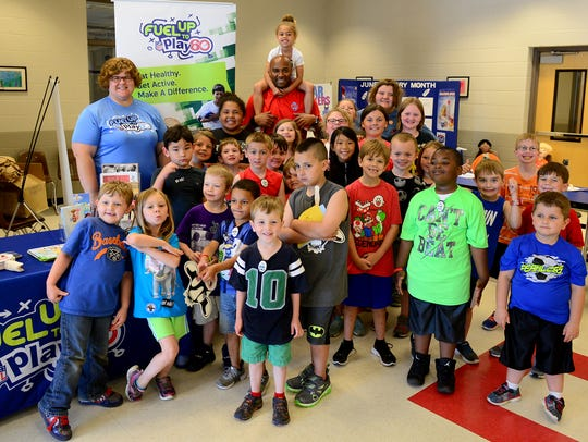 Students in the YMCA Summer program pose with former