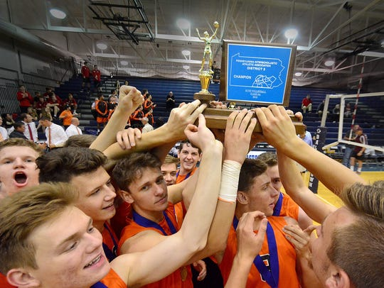 The Northeastern players celebrate after winning their District 3 Class 2-A boys' volleyball title on Friday. BIL BOWDEN PHOTO