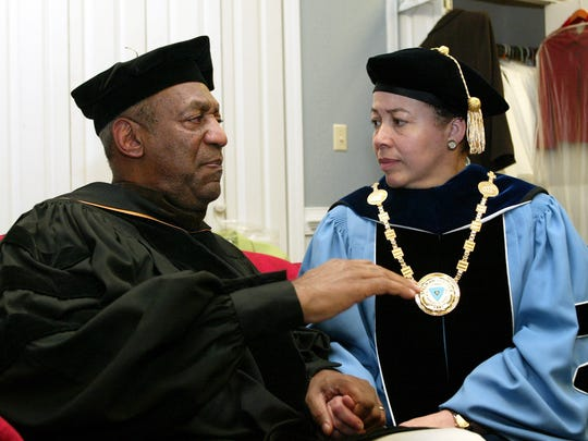 Keynote speaker Bill Cosby and Spelman College President Dr. Beverly Tatum talk before the start of commencement at the school May 14, 2006, in Atlanta. Cosby's legacy of giving is decades-old and extensive, topped by a $20 million gift to Spelman College in 1988.