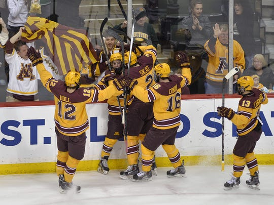 Minnesota players celebrate their first goal during the first period Sunday of the NCAA West Regional final at Xcel Energy Center in St. Paul. The Gophers won the game, 4-0. Minnesota players celebrate their first goal during the first period March 30 of the NCAA West Regional final at Xcel Energy Center in St. Paul.