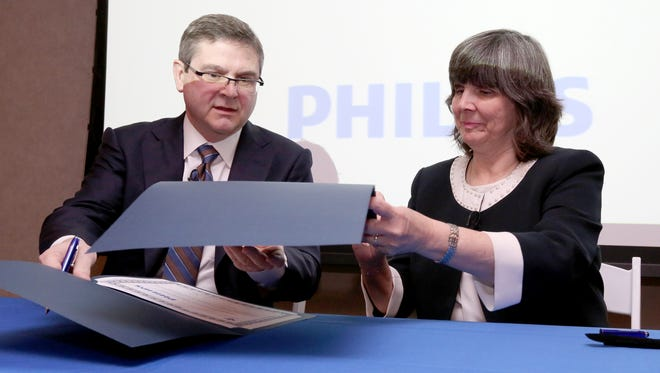 Joe Robinson, senior vice pres. health care solutions at Philips, and Mary Leahy, MD, CEO of Bon Secours Charity Health System, sign a partnership agreement at Good Samaritan Hospital in Suffern Jan. 26, 2017.