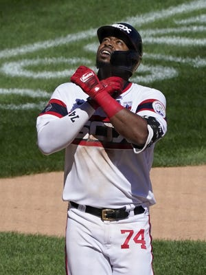 Chicago White Sox's Eloy Jimenez celebrates his home run off St. Louis Cardinals relief pitcher Roel Ramirez during the fifth inning Sunday, Aug. 16, 2020, in Chicago. Jimenez's home run was the fourth in a row given up by Ramirez.