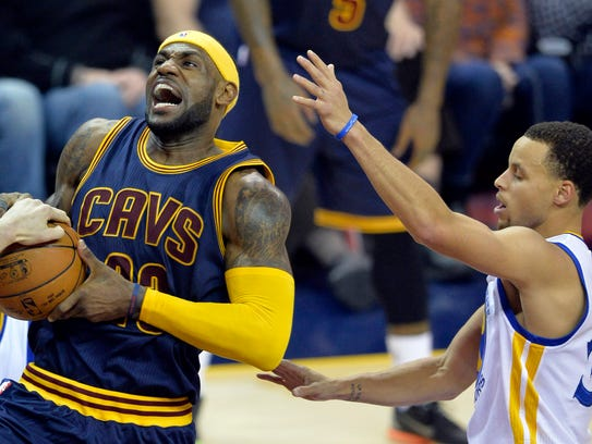Cleveland Cavaliers forward LeBron James (23) drives