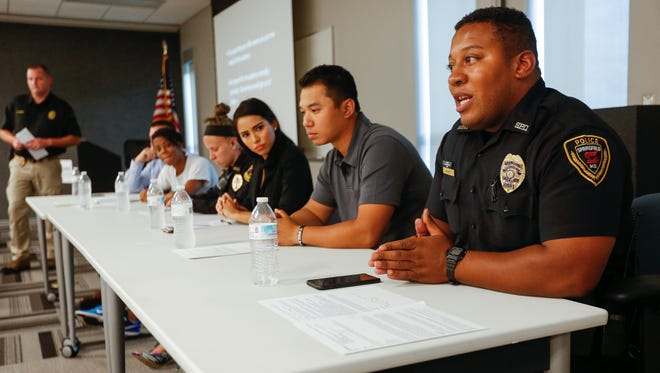 Officer Jerome Lockett, right, answers a question while participating in a diversity panel during one of Springfield police's recruiting sessions on Wednesday, July 5, 2017. The panel was made up of six officers including a gay man, black woman, white woman, Hispanic woman, Asian man and a black man.