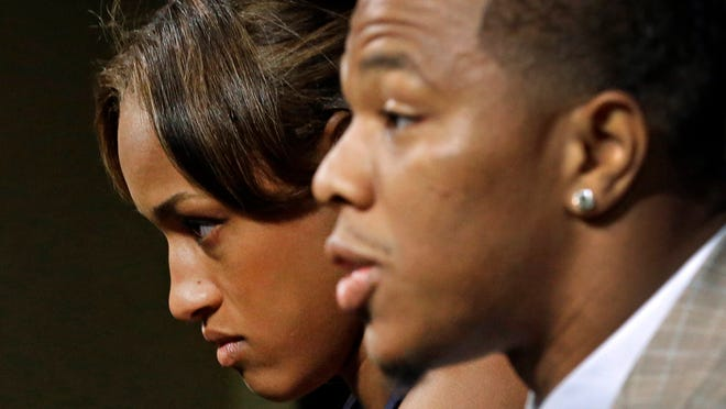 Janay Rice, left, looks on as her husband, Baltimore Ravens running back Ray Rice, speaks to the media during a news conference in Owings Mills, Md., on May 23, 2014.