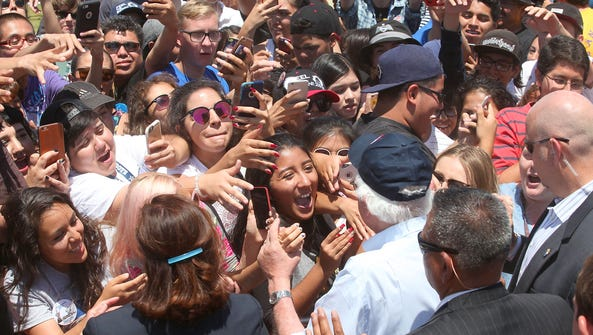 Bernie Sanders greets an ecstatic crowd after speaking