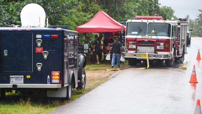 In this file photo, personnel from the Guam Fire Department, Guam Police Department, Guam National Guard, Offices of Guam Homeland Security and Civil Defense and other emergency responders gather outside the residence of 170 Anao Road in Yigo on Tuesday, Jan. 24, 2017. Emergency vehicles will parade from Agana Heights to Adelup Tuesday.