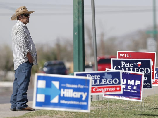 Campaign signs line the sidewalk outside the Pavo Real Recreation Center early voting site.