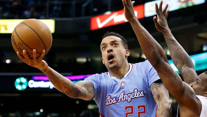The Clippers' Matt Barnes (22) drives past the Suns' Eric Bledsoe (2) during their game in Phoenix.