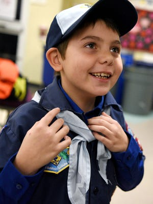 Joe Maldonado of Secaucus, N.J., the first openly transgender member of the Boy Scouts of America, shows off the uniform he received from Kyle Hackler, leader of Cub Scouts Pack 20 of Maplewood/South Orange, N.J.