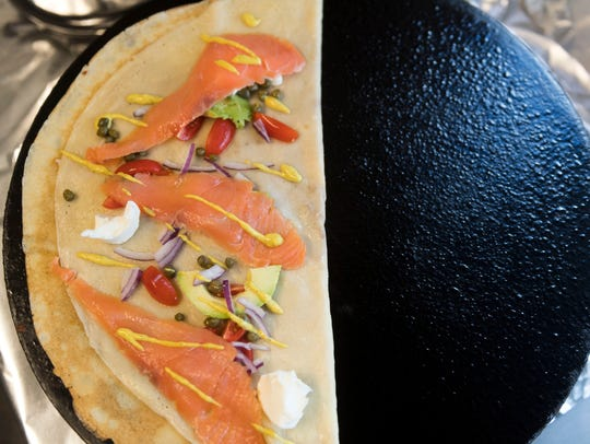 Smart Crepes' smoked salmon crepe cooks on a crepe maker.