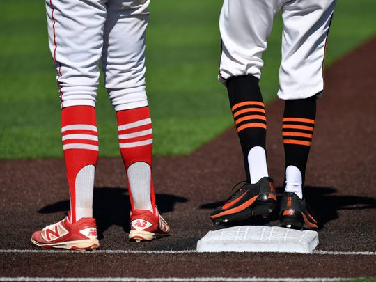 Burkburnett base runner Cole Schultz stands on the bag as he and Sweetwater first baseman Antonio Heredia wait for the next batter Thursday. This was Game 1 in the first round of the Class 4A baseball playoffs held at Abilene Christian University.