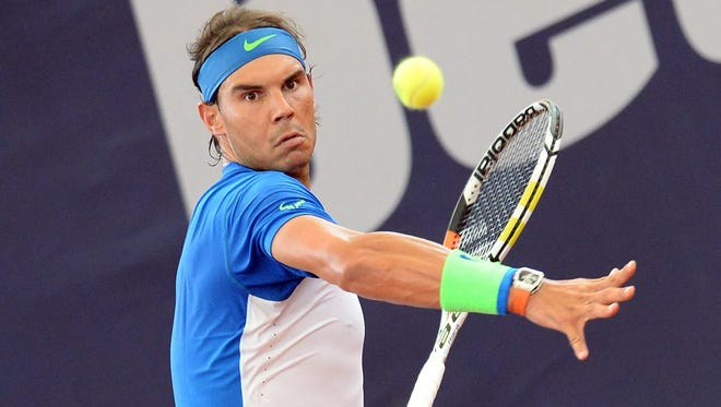Rafael Nadal of Spain in action during his first round match against compatriot Fernando Verdasco  at the Hamburg Open.