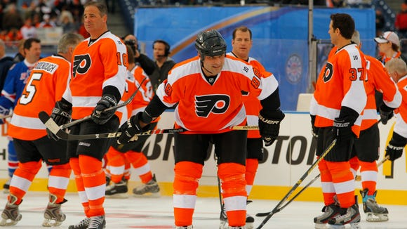 Eric Lindros, center, and John LeClair, left, will be honored by the team Nov. 20. Eric Desjardins (37) will be honored Feb. 19.