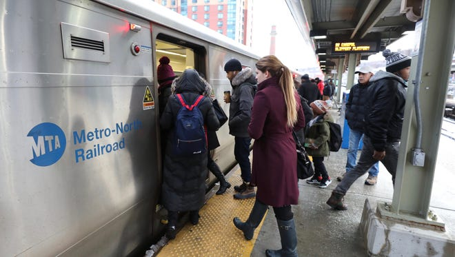 Commuters board a southbound train from the Yonkers station on March 22.