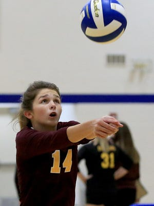 Hays' McKenzie Flax (14) passes the ball during their game against Smoky Valley Tuesday in Nickerson. Smoky Valley defeated Hays 25-19, 25-12.