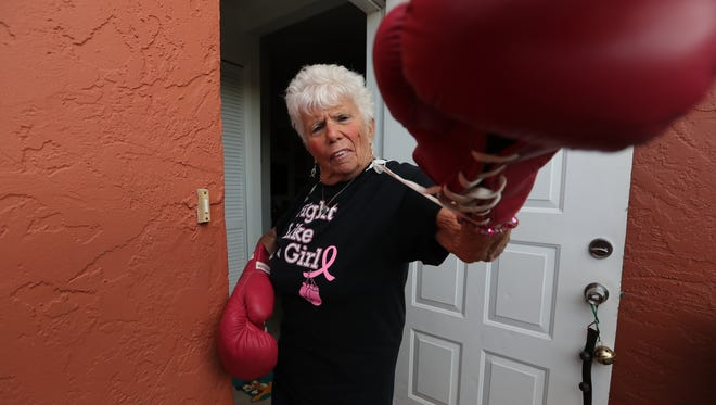 Cape Coral resident Carol Polis displays a pair of gloves from her collection during a recent interview. Polis was professional boxing's first female judge.