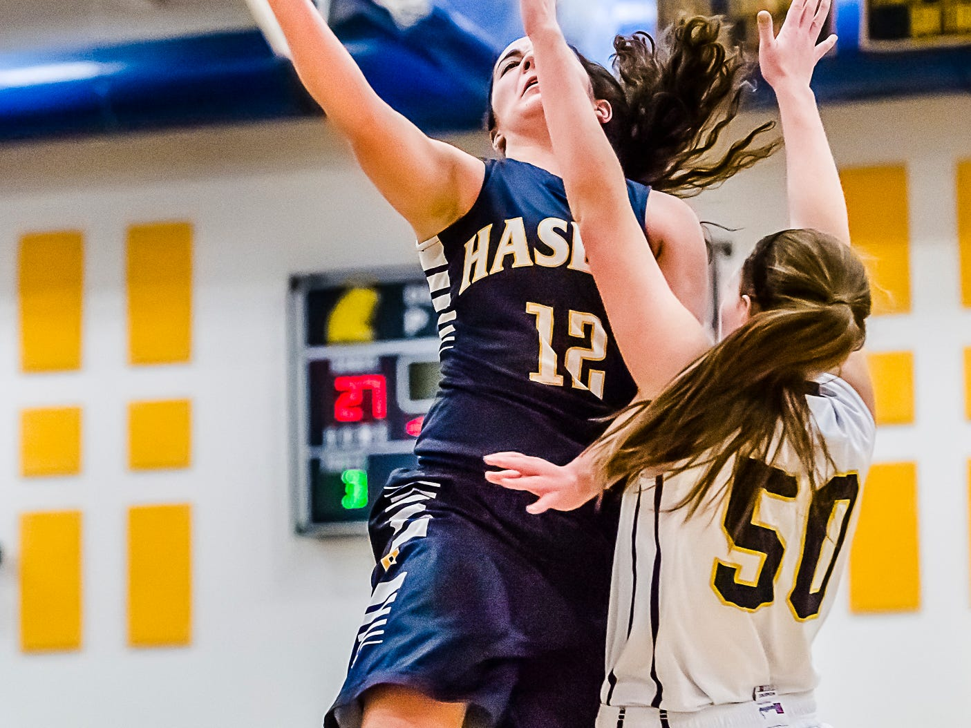 Haslett's Megan Mowid had 16 points Friday to help the Class B top-ranked Vikings post a 55-44 win over Class A No. 1 DeWitt.