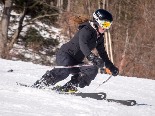 Skiing down one of the hills at Bristol Mountain.