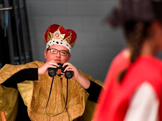 "King George, played by Gavin Sheffer keeps his eyes on the colonies in the Holy Name School eighth grade class' production of ""The American Revolution in 40 Minutes or Less"" Friday, April 28, 2017."