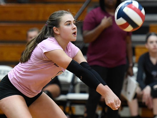 Henderson's Cayce Chaykowsky (6) with a backcourt dig as Henderson County plays long-time rival Caldwell County in the Second Region Volleyball Tournament championship at Trigg County High School Thursday, October 26, 2017.