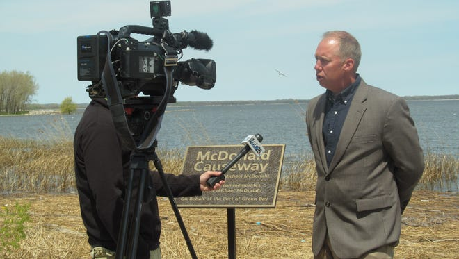 Port Director Dean Haen answers a reporter's questions about the McDonald Causeway.