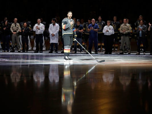 Vegas Golden Knights defenseman Deryk Engelland speaks during a ceremony to honor the first responders of the shooting in Las Vegas before an NHL hockey game Tuesday, Oct. 10, 2017, in Las Vegas. (AP Photo/John Locher)