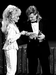 Dolly Parton presents Steven Curtis Chapman the Artist of the Year award during the Dove Awards on April 5, 1990.