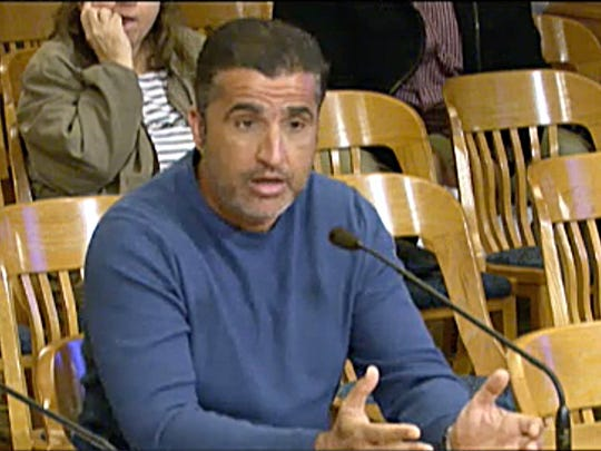 Youssef Berrada, a landlord who owns more than 300 buildings and 3,500 rental units in the Milwaukee area, appears before a City of Milwaukee zoning hearing to acquire another property in April 2018.