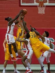 Bosse's D'Angelo Ware (3) reaches over Central's Collin