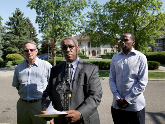 Detroit mayoral candidate Tom Barrow, center, Robert