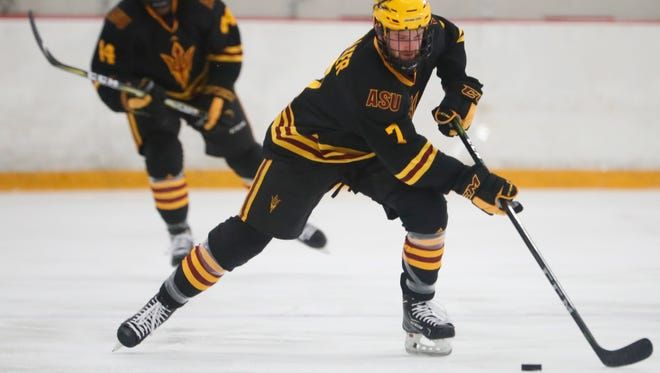 Johnny Walker skates up the ice with the puck during a game against UMass-Lowell on Jan. 12 at Oceanside Ice Arena.