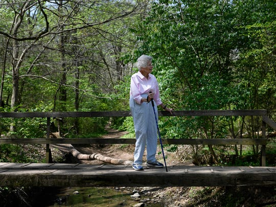 Laura Lea Knox enjoys hiking along the Harpeth Woods Trail in Edwin Warner Park Friday, April 14, 2017 in Nashville, Tenn. Knox is the granddaughter of Percy Warner and the great niece of Edwin Warner, she and the Warner Parks turn 90 this year.