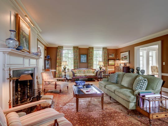 The Henry Canby House retains  original features such as a pristine bronze chandelier, Greek key molding, deep window sills and marble fireplaces.