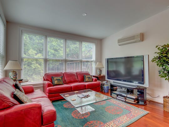 The unit's waterfront location, contemporary open layout,