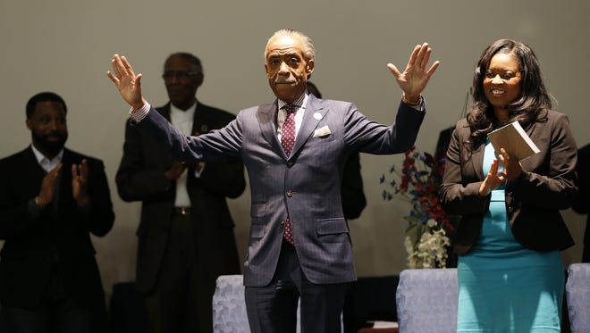 Rev. Al Sharpton, left, joins State Representative Alicia Reece to kick off the petition drive for Ohio Vote at Word of God Deliverance Family Life Center in Forest Park.