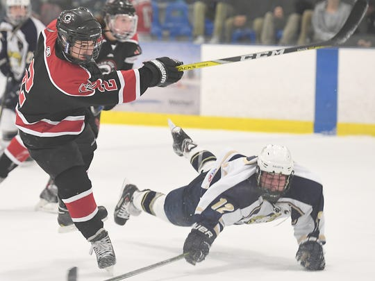 Glen Rock vs. Ramsey at the Ice Vault Arena in Wayne on Friday, Dec. 9, 2016.  GR #2 Eddie Corvelli takes a shot as R #12 Dan Halik dives to block the puck in the second period.