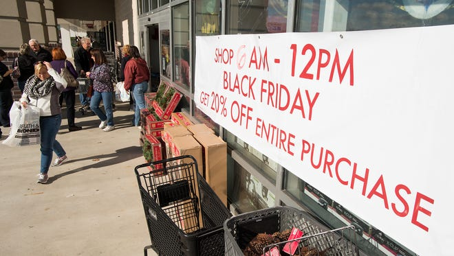 Customers stream in and out of the Bed, Bath and Beyond at the Tanger Outlets in West Ocean City on Black Friday morning.