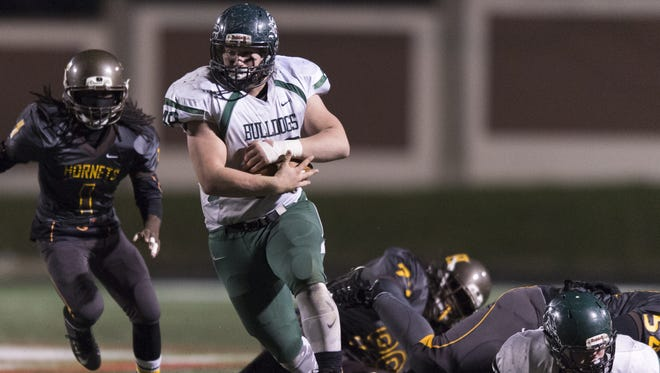 Monrovia High School junior Garrison Lee (48) rushes the ball through the Howe defense during the second half of an IHSAA Class 2A Football Semi-State game, Friday, Nov. 20, 2015, at Arsenal Technical High School in Indianapolis. Monrovia won 37-31.