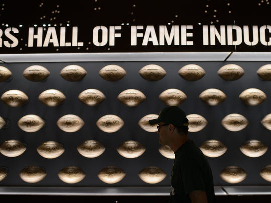 Wolf-Dieter Obst of Stuttgart, Germany, walks past the many Packers Hall of Fame inductees in their new location inside Lambeau Field in Green Bay.