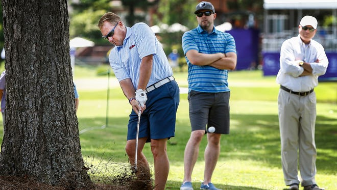 Ole Miss football coach Hugh Freeze hits out of the deep rough on the 10th hole while playing in the InnerWorkings Pro-Am at the FedEx St. Jude Classic at TPC Southwind on June 7, 2017.